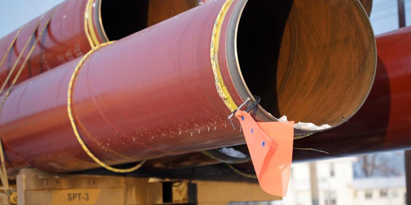 flatbed trucking solution for oil pipeline